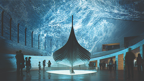 Photo of a viking ship in an exhibition space, bathed in blue light