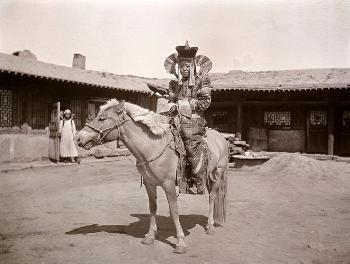 Mongolian girl, Ulan Bator 1912. The house where Oscar Mamen stayed is seen in the background.