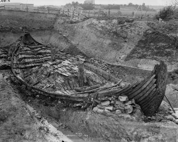 The Oseberg ship in the burial mound.